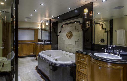 Ensuite with bath and sink on on superyacht M3