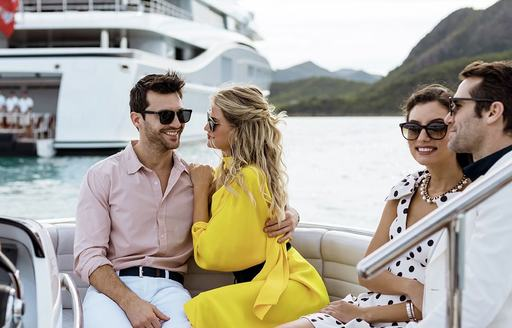 a group of young couples enjoying their ride on to the shores of the amalfi coast while on their luxury yacht charter through the Mediterranean