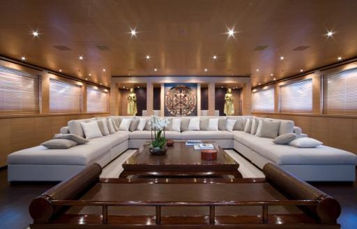 huge u-shaped sofa in main salon of luxury yacht MISCHIEF