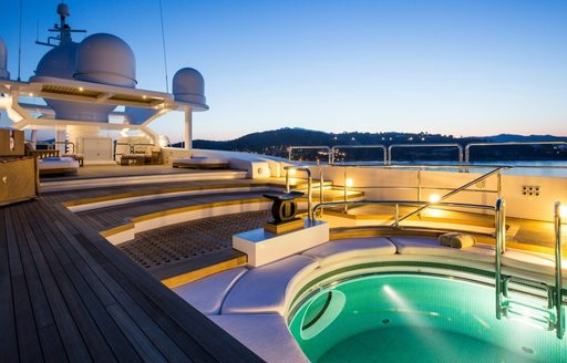 Pool on sundeck of superyacht Coral Ocean lights up at night