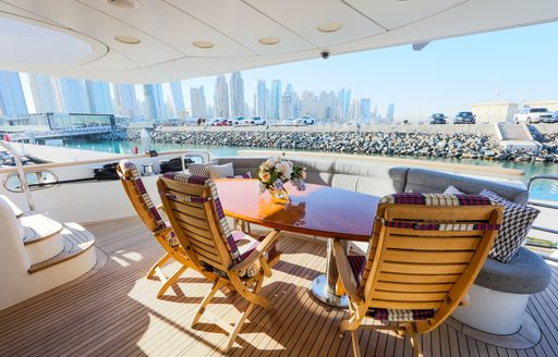 alfresco dining on main deck aft of charter yacht DXB