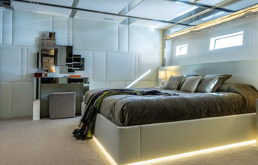 Double bed and light furnishings on motor yacht Cinquanta 50