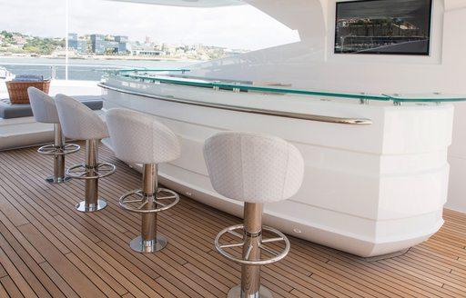 long sundeck bar with bar stools under the radar arch on board charter yacht 'Princess AVK'