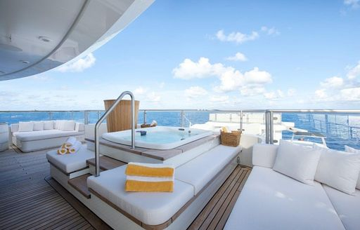 deck Jacuzzi surrounded by sunpads on board super yacht SENSES