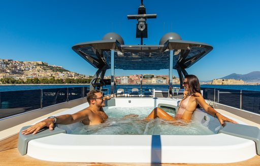 charter guests relax on board luxury yacht penelope