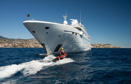 Charter guest riding Jet-Skis around superyacht Lauren L