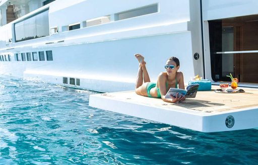 charter guest lies out on yacht in the caribbean