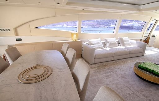 Table and sofa in interior charter yacht NEOPRENE