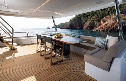 aft deck dining set up on superyacht moana ii