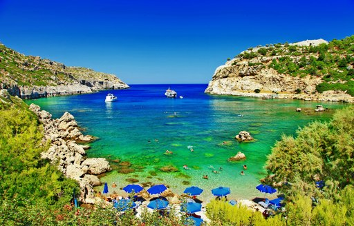 pretty green bay and sparkling clear cove in greece