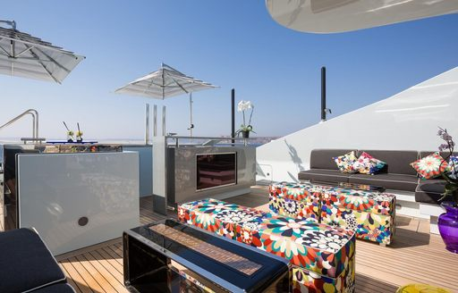 superyacht ocean paradise's deck seating area with television