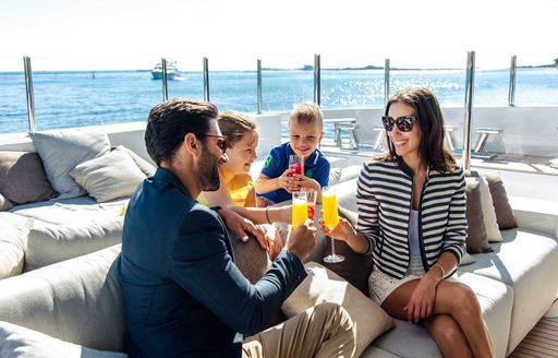 family of guests on luxury yacht charter in greece