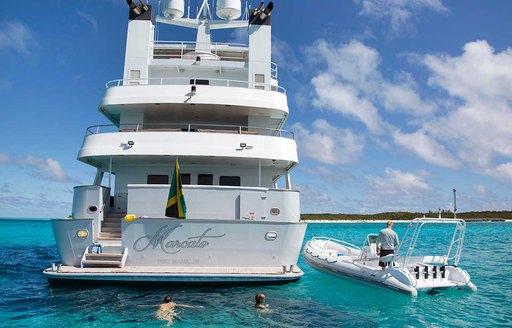 View of stern of explorer yacht MARCATO with RIB tender next to it