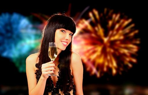 a charter guest sips champagne while watching the fireworks in Sydney Harbour
