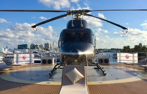helicopter on the helipad of charter yacht CLOUDBREAK at FLIBS 2017