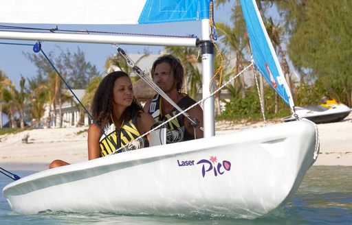 people sailing in boats around thanda island