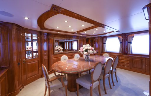 formal dining area in the classically styled main salon aboard charter yacht DXB