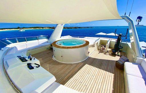 Jacuzzi and teak sundeck on superyacht LIONSHARE