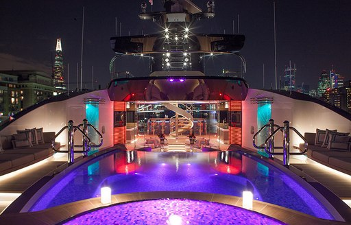 Pool area lit up at night onboard MY Kismet