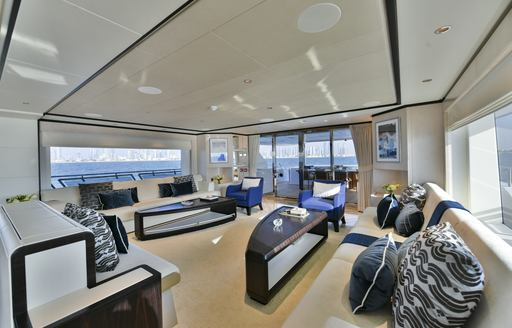 Sofas and tables in salon on Majesty 120 superyacht