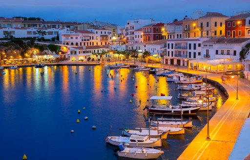 A port at night in Minorca