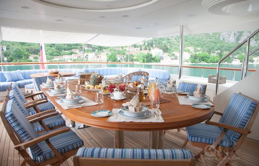 alfresco dining area on the upper deck aft of superyacht JO