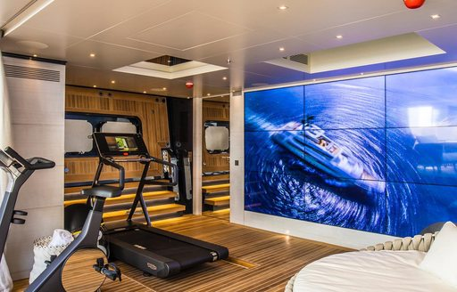 Large video wall in gym area on superyacht SEVERIN'S, with gym equipment visible