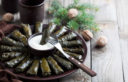 Plate with Dolma - stuffed grape leaves with meat