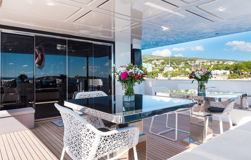 Covered dining area on deck of motor yacht Cinquanta 50