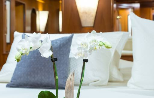 detailed shot of flower at foot of bed on motor yacht over the rainbow