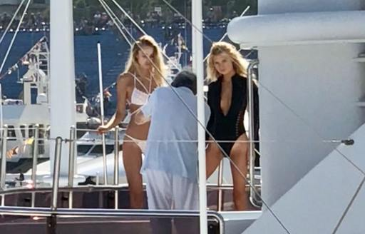 Models posing on the deck of a yacht at the Monaco Grand Prix 2018
