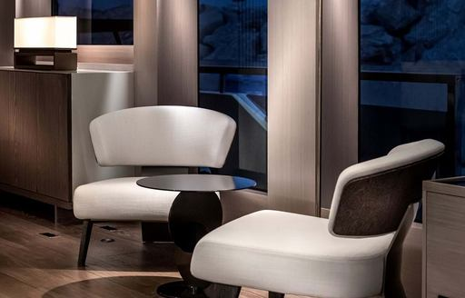 Close up of elegant chairs and table on explorer yacht 'Seven Diamonds'