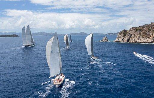 yachts cut through the water in Sardinia as part of the LORO PIANA SUPERYACHT REGATTA
