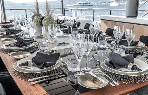 Fully laid dining table on superyacht SEVERIN'S
