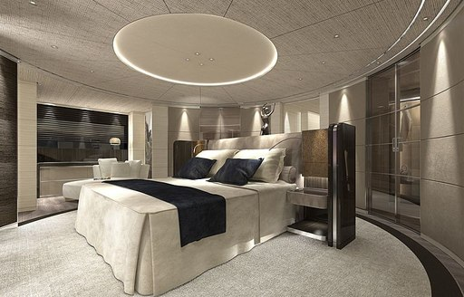 Elegant cabin on superyacht SEVERIN'S, showing double bed and light colored furnishings