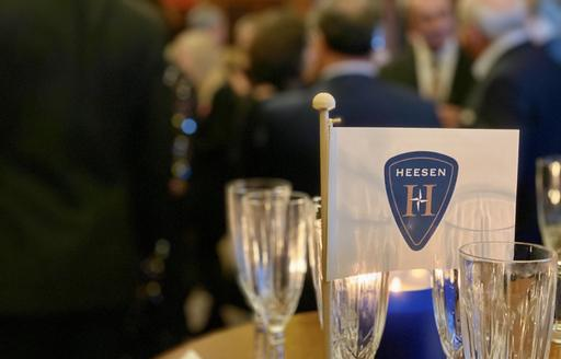 Champagne flutes and Heesen flag at Heesen press event for Cosmos in London