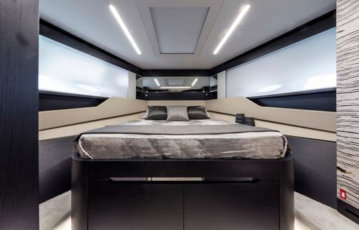 Double bed in cabin on motor yacht BEYOND