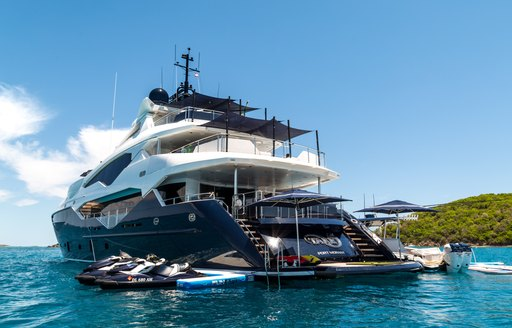motor yacht Take 5 anchored on a Mediterranean yacht charter with toys