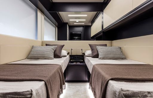 Twin beds in cabin on motor yacht BEYOND with mirror behind