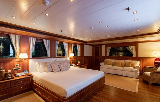 Large cabin on superyacht Bleu De Nimes with bed and sofa