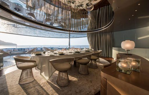 Covered outdoor dining area on superyacht SAVANNAH