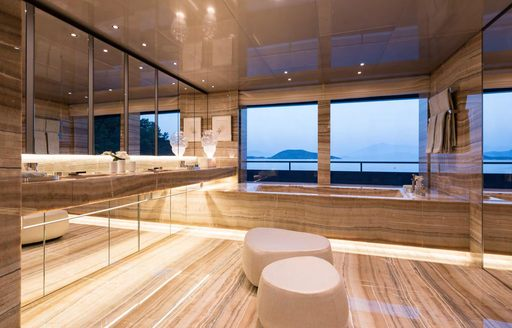 Beautiful en-suite on superyacht SAVANNAH with bath and windows looking out to see