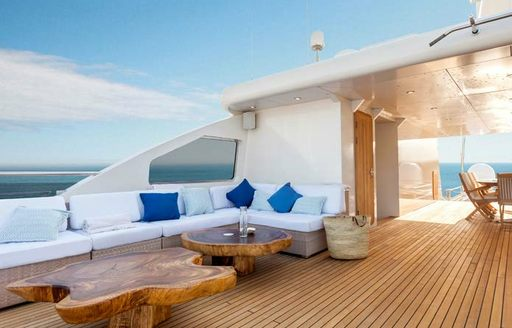 Comfortable seating and teak deck on O'MEGA superyacht