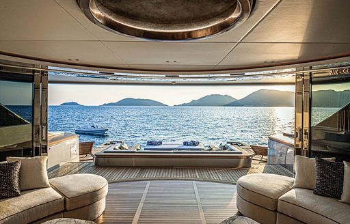 Doors open and looking out across beach club area on Benetti superyacht REBECA