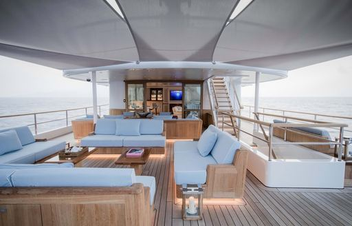Covered outdoor sitting area on explorer yacht 'Blue II'