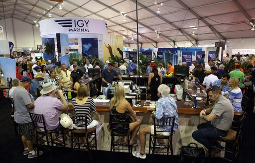 show-goers gather in the bar for a refreshing drink at FLIBS