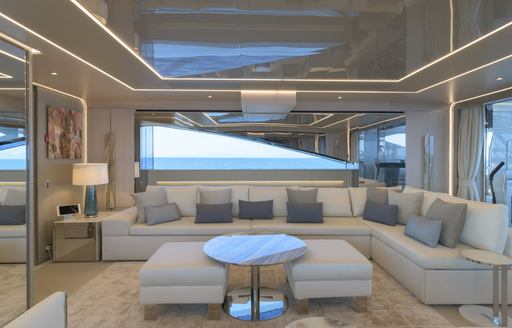 Comfortable pale seating on superyacht EIV