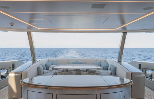 Covered dining area on superyacht EIV
