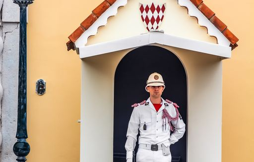 guard outside doors to palace in monaco