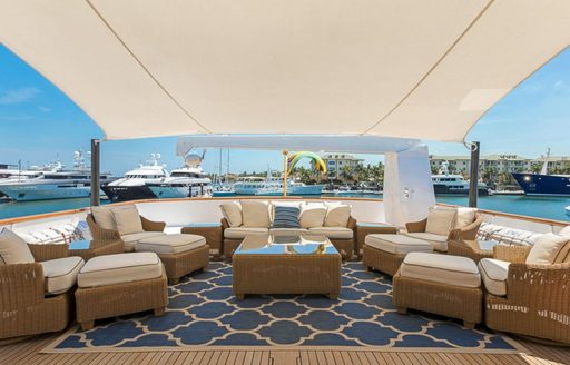 chic alfresco lounge with shade on board motor yacht PRAXIS